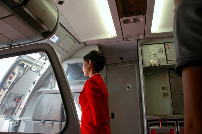 What does a flight attendant do during a flight?